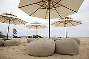 Ritz Carlton in Sanya, Yalong Bay. Sands Bar with tables and bean bags on the beach.