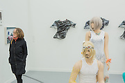 "New York, NY - 6 May 2016. Frieze New York art fair. A sculptured fugure of a woman, part of a group titled ""Seastead Figures (Polypool)"", by David Keller and Ella Plevin in the gallery of Kraupa-Tuskany Zeidler of Berlin, seem to look at a gallery visitor."