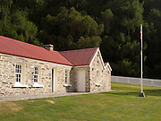 The historic Skipper's Point School and flagpole, near Queenstown, Otago, New Zealand.
