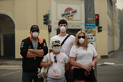 Jan. 2, 2020, Canberra, Australia: Local residents wear facial protections against poor air quality. The country's capital is chocking in smoke from bushfires. According to the Nine News, Canberra's air quality is now the worst out of all major cities in the world.