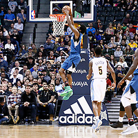 15 February 2017: Minnesota Timberwolves forward Andrew Wiggins (22) goes for the dunk during the Minnesota Timberwolves 112-99 victory over the Denver Nuggets, at the Pepsi Center, Denver, Colorado, USA.