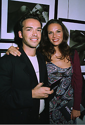 MR HENRY DENT-BROCKLEHURST the multi millionaire owner of Sudley Castle and his fiance MISS LILI MALTESE, at a party in London on 10th September 1997.MBB 36