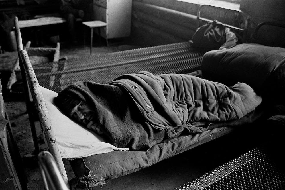 Resident of  house for an old released prisoners lays on his bed in barrack where he lives in a village Blagoveshenka, Kemerovo region, Eastern Siberia, Russia, 07 December 1999. Blagoveshensky house for an old former prisoners a special institution which is a part of a penitentiary system where live former prisoners which have age more then 55 years after released and haven't house or an apartment and relatives.