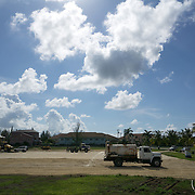 MAY 29, 2015---GRAND CAYMAN, CAYMAN ISLANDS----<br /> Workers labor in filling in part of the lot where the CIFA (Cayman Islands Football Association) has been expected to build facilities since 2009. This project started about one month ago. The former President of the CIFA, Jeffrey Webb, was arrested in Zurich for alleged corruption. Webb was President of CIFA and CONCACAF and is Vice PResident of FIFA. (Photo by Angel Valentin/Freelance)
