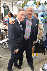 Left to right, DAVID FURNISH and JEAN PIGOZZI at the launch of the new collection from Limoland held at Anderson & Sheppard's Haberdashery, 17 Clifford Street,London on 16th June 2014.