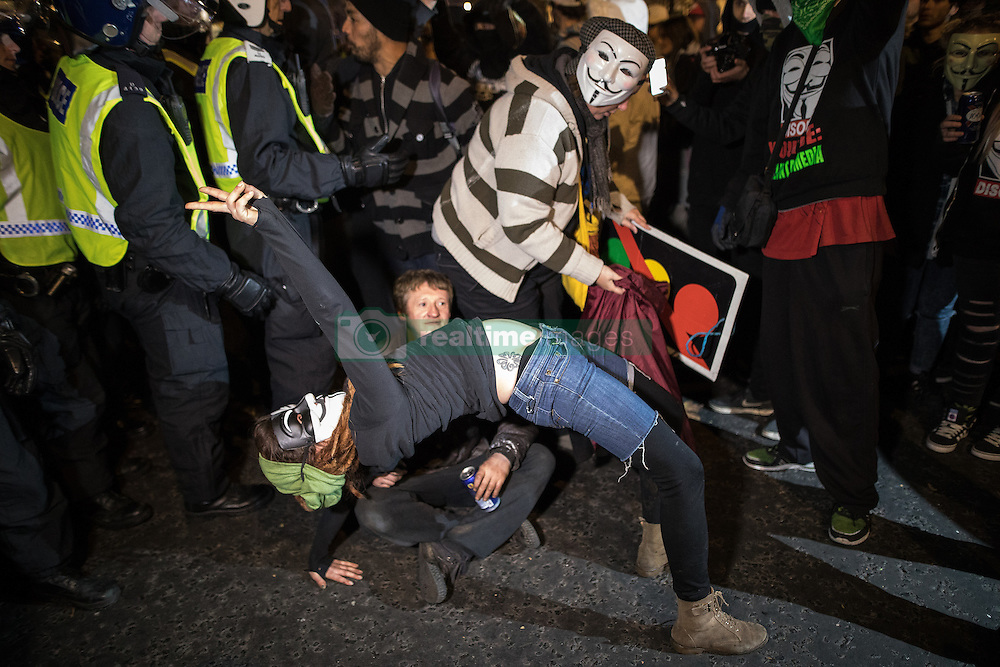 November 5, 2016 - London, London, UK - London , UK . Supporters of Anonymous , many wearing Guy Fawkes masks , attend the Million Mask March bonfire night demonstration , in Trafalgar Square in central London  (Credit Image: © Joel Goodman/London News Pictures via ZUMA Wire)