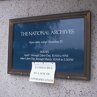 A paper sign is posted at the entrance to the National Archives during the 1990 shutdown of the federal government