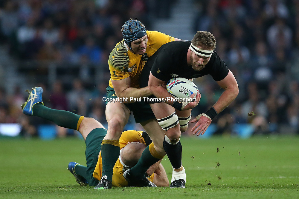 New Zealand's Kieran Read is tackled by Australia's Stephen Moore (L) and David Pocock. Rugby World Cup Final, New Zealand All Blacks v Australia, Twickenham Stadium, London, England. Saturday 31 October 2015. Copyright Photo: Paul Thomas / www.Photosport.nz