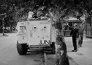 Mostar, Bosnia, June 1993.<br /> <br /> Mostar civilian attempting to sell ties to Spanish UN soldiers.