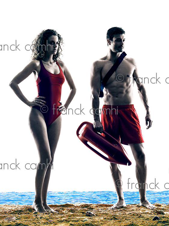 one caucasian couple man and woman lifeguards  on the beach silhouette isolated on white background
