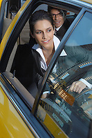 Businesswoman sitting in taxi and looking out window