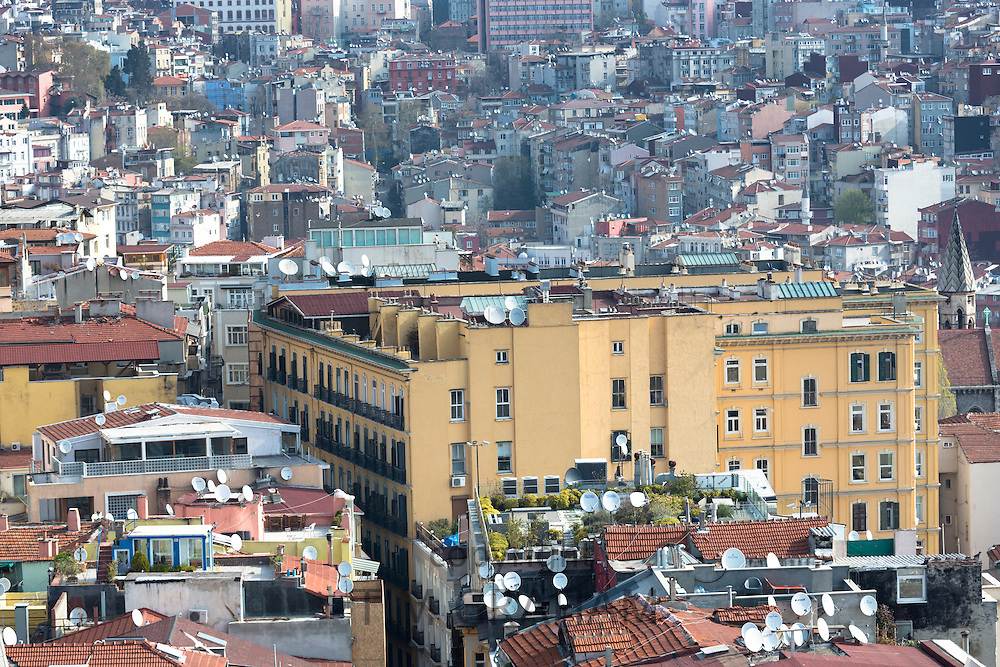 Skyline cityscape apartment blocks and offices of Karakoy and Beyoglu and satellite dishes infrastructure in Istanbul, Turkey