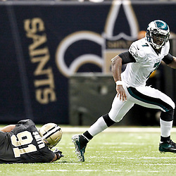 November 5, 2012; New Orleans, LA, USA; Philadelphia Eagles quarterback Michael Vick (7) runs from New Orleans Saints defensive end Will Smith (91) during the second half of a game at the Mercedes-Benz Superdome. The Saints defeated the Easgles 28-13. Mandatory Credit: Derick E. Hingle-US PRESSWIRE