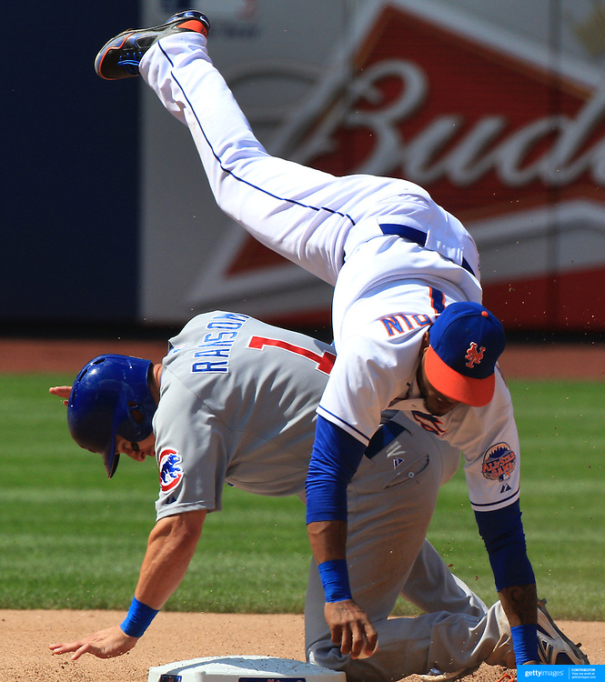 Jordany Valdespin, New York Mets, tumbles over Cody Ransom, Chicago Cubs, during a failed double play attempt during the New York Mets V Chicago Cubs Baseball game at Citi Field, Queens, New York. USA. 15th June 2013. Photo Tim Clayton