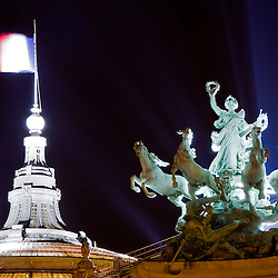Statue and French flag on the roof of the Grand Palais at night, Paris, France, Europe