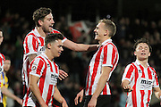 Danny Wright is congratulated by his team mates after scoring a penalty during the Vanarama National League match between Cheltenham Town and Altrincham at Whaddon Road, Cheltenham, England on 19 December 2015. Photo by Carl Hewlett.