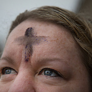 "ALEXANDRIA, VA - MAR1: Elizabeth Oakes, who works at the Department of Commerce, got ""glitter ashes"" for Ash Wednesday, outside the Braddock Road metro station, in Alexandria, VA, March 1, 2017. Across the country, churches involved with the advocacy group Parity will be giving out ""glitter ashes"" to demonstrate that LGBT people should be included in Christianity.(Photo by Evelyn Hockstein/For The Washington Post)"
