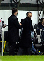 Photo: Jed Wee.<br /> Newcastle United v Chelsea. Carling Cup. 20/12/2006.<br /> <br /> Chelsea manager Jose Mourinho (R) makes up with Newcastle counterpart Glenn Roeder after a spat over a perceived booking.