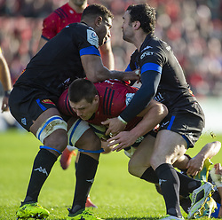 December 9, 2018 - Limerick, Ireland - CJ Stander of Munster tackled by Thomas Combezou and Mathieu Babillot of Castres during the Heineken Champions Cup Round 3 match between Munster Rugby and Castres Qlympique at Thomond Park Stadium in Limerick, Ireland on December 9, 2018  (Credit Image: © Andrew Surma/NurPhoto via ZUMA Press)