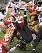 Baltimore Ravens wide receiver Jacoby Jones, center, is upended by the San Francisco 49ers during the third quarter of Super Bowl XLVII at the Mercedes-Benz Superdome on February 3, 2013 in New Orleans.  UPI/David Tulis