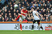 Nottingham Forest defender Bojan Jokic crosses the ball during the Sky Bet Championship match between Derby County and Nottingham Forest at the iPro Stadium, Derby, England on 19 March 2016. Photo by Jon Hobley.