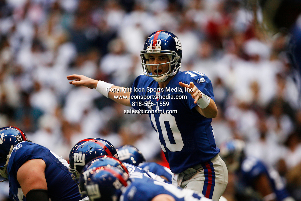 13 January 2008:<br /> New York Giants quarterback Eli Manning (10) calls an audible at the line of scrimmage in the first half of the New York Giants vs. Dallas Cowboys NFC Divisional Playoff football game at Texas Stadium on Sunday January 13, 2008 in Irving, Texas. New York won 21-17 to advance to the NFC Championship against Green Bay.