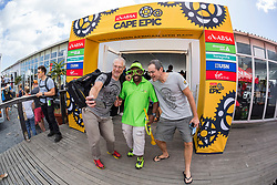 Riders taking a selfie with the Exxaro Mascot during the pre race events held at the V&A Waterfront in Cape Town prior to the start of the 2017 Absa Cape Epic Mountain Bike stage race held in the Western Cape, South Africa between the 19th March and the 26th March 2017<br /> <br /> Photo by Dominic Barnardt/Cape Epic/SPORTZPICS<br /> <br /> PLEASE ENSURE THE APPROPRIATE CREDIT IS GIVEN TO THE PHOTOGRAPHER AND SPORTZPICS ALONG WITH THE ABSA CAPE EPIC<br /> <br /> ace2016