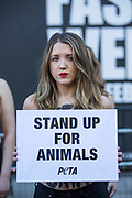 UNITED KINGDOM, London: 16 February 2018 A group of female PETA (People for the Ethical Treatment of Animals) protesters stand topless outside of 180 The Strand, the venue for London Fashion Week. The activists had 'Wear Your Own Skin' painted on their bodies to encourage passers by not to wear animal derived materials. Rick Findler / Story Picture Agency