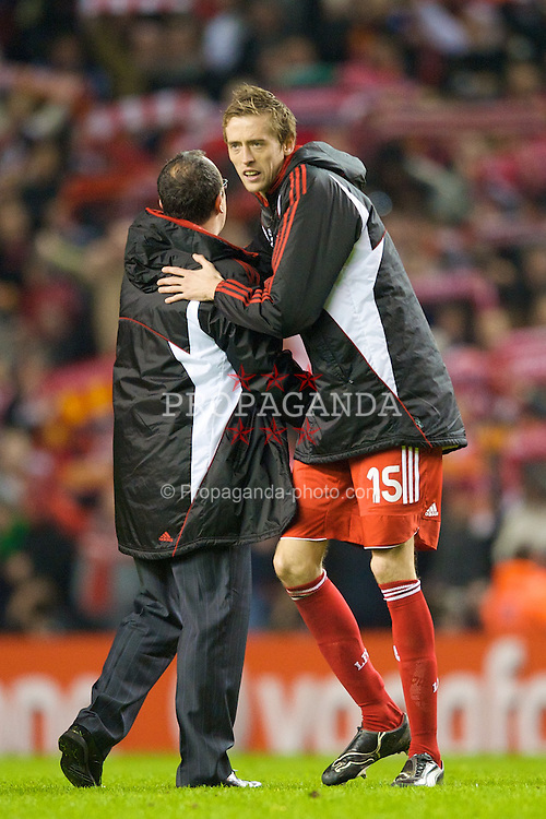 LIVERPOOL, ENGLAND - Tuesday, April 8, 2008: Liverpool's manager Rafael Benitez congratulates Peter Crouch after his side's 4-2 victory over Arsenal after the UEFA Champions League Quarter-Final 2nd Leg match at Anfield. (Photo by David Rawcliffe/Propaganda)