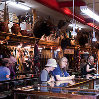 Customers browse jewelry and other goods at Richardson's Trading Company in Gallup on Saturday.