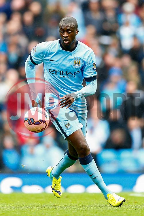 Yaya Toure of Manchester City in action - Photo mandatory by-line: Rogan Thomson/JMP - 07966 386802 - 30/08/2014 - SPORT - FOOTBALL - Manchester, England - Etihad Stadium - Manchester City v Stoke City - Barclays Premier League.