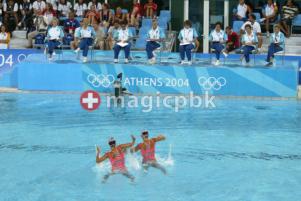 Brazilian swimmers Carolina and Isabela Moraes perform in front of the officials in the Synchronised Swimming Pool Duet Technical Routine of the Athens 2004 Olympic Games at the Olympic Aquatic Centre in Athens Monday 23 August 2004. (Photo by Patrick B. Kraemer / MAGICPBK)