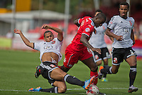 Louis Thompson, Striker with Swindon Town FC & Izale McLeod, Forward with Crawley Town FC during Crawley Town v Swindon Town, Sky Bet League One, Checkatrade.com Stadium, Crawley, Saturday 16th August, 2014.