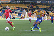 CJ Hamilton of Mansfield Town (22) shoots and scores a goal to make it 1-0 to Mansfield Town during the The FA Cup match between Mansfield Town and Charlton Athletic at the One Call Stadium, Mansfield, England on 11 November 2018.