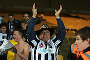 Maidenhead fan celebrates the result of the The FA Cup match between Port Vale and Maidenhead United at Vale Park, Burslem, England on 8 November 2015. Photo by Jemma Phillips.