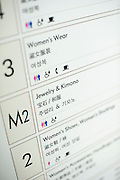 Photo shows a floor guide written in English, Mandarin and Hangul (Korean) at the entrance to the Mitsukoshi department store in the Ginza district of Tokyo, Japan on Tuesday 16 Nov. 2010..Photographer: Robert Gilhooly