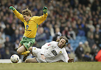 Photo: Aidan Ellis.<br /> Leeds United v Norwich City. Coca Cola Championship. 11/03/2006.<br /> Leeds Shaun derry brings down Norwich's Paul McVeigh