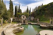 Laghetto delle danze, a violin-shaped stone pond in memory of Gasparo da Salo, inventor of the violin, where small quartet recitals were held, at the Vittoriale degli italiani, or The Shrine of Italian Victories, the home, estate and museums of Gabriele D'Annunzio, 1863-1938, Italian writer, soldier and fascist, at Gardone Riviera, Lake Garda, Brescia, Lombardy, Italy. The estate consists of the Prioria, where d'Annunzio lived 1922-38, an amphitheatre, the protected cruiser Puglia, the MAS vessel used by D'Annunzio in 1918 and a mausoleum. It is part of the Grandi Giardini Italiani. Picture by Manuel Cohen