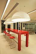 Red table  and chairs for the reception area in Rio Tinto's new Headquarters in Paddington, London