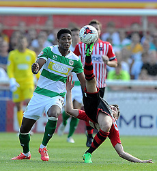 Yeovil Town's Sean Jeffers is tackled by Exeter City's Aaron Davies - Photo mandatory by-line: Harry Trump/JMP - Mobile: 07966 386802 - 08/08/15 - SPORT - FOOTBALL - Sky Bet League Two - Exeter City v Yeovil Town - St James Park, Exeter, England.