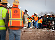 Workers stand by at a construction accident near the Jon M. Huntsman Center where a steel beam shifted balance and fell, injuring three workers. Two were taken immediately to the hospital and one was treated on scene, Monday, Dec. 17, 2012.