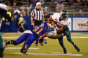 Sacramento State Hornets running back EZEKIEL GRAHAM (8) breaks through a tackle by San Jose State Spartans linebacker KEITH SMITH (31) during the season opener at San Jose State University's Spartan Stadium in San Jose, California, on August 29, 2013. The San Jose State Spartans beat the Sacramento State Hornets 24-0. (Stan Olszewski/ZUMA Press)