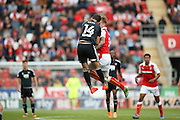 Brentford  defender John Egan (14)  challenges Rotherham United midfielder Danny Ward (9)  in the air  during the EFL Sky Bet Championship match between Rotherham United and Brentford at the New York Stadium, Rotherham, England on 20 August 2016. Photo by Simon Davies.