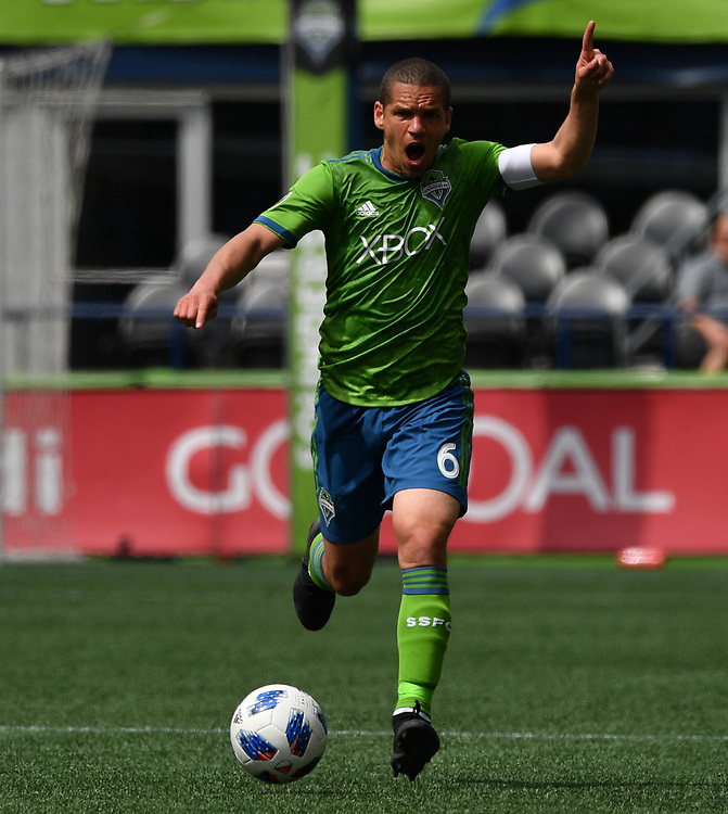 May 05, 2018; Seattle, Washington, US;  Seattle Sounders midfielder Osvaldo Alonso (6) directs his teammate during in action between the Seattle Sounders FC and Columbus Crew at Century Link Field. Photo credit: Rick May - Rick May Photography