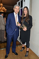 SIR STUART ROSE and ELIZABETH SALTZMAN at a party hosed by the US Ambassador to the UK Matthew Barzun, his wife Brooke Barzun and editor of UK Vogue Alexandra Shulman in association with J Crew to celebrate London Fashion Week held at Winfield House, Regent's Park, London on 16th September 2014.