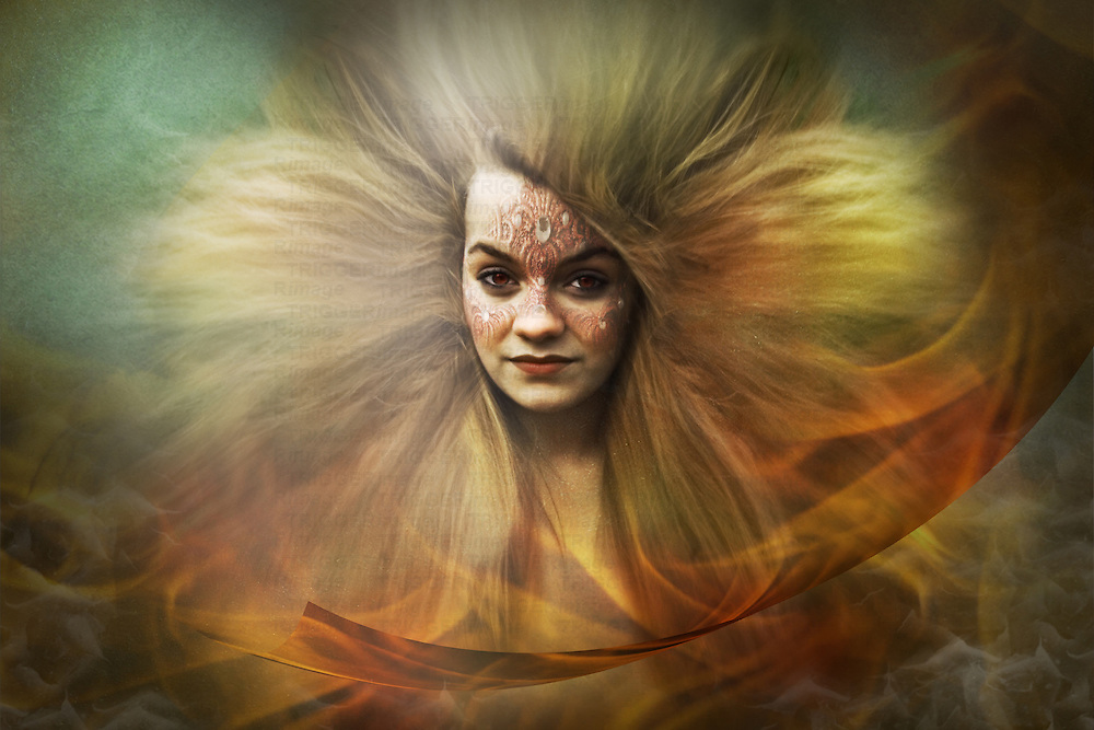 fantasy image of a female wearing a mask and flowing hair with flames around her