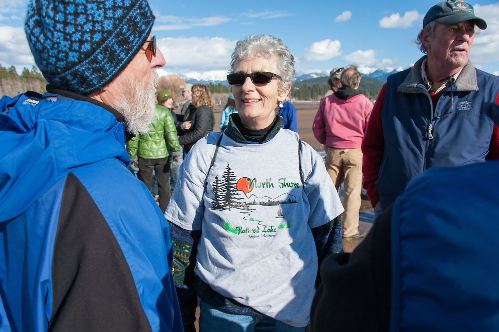 A woman wearing a North Shore tshirt at the Stop the Bridge public rally and demonstration on the north shore of Flathead Lake organized by CANSC (Community Association for North Shore Conservation).