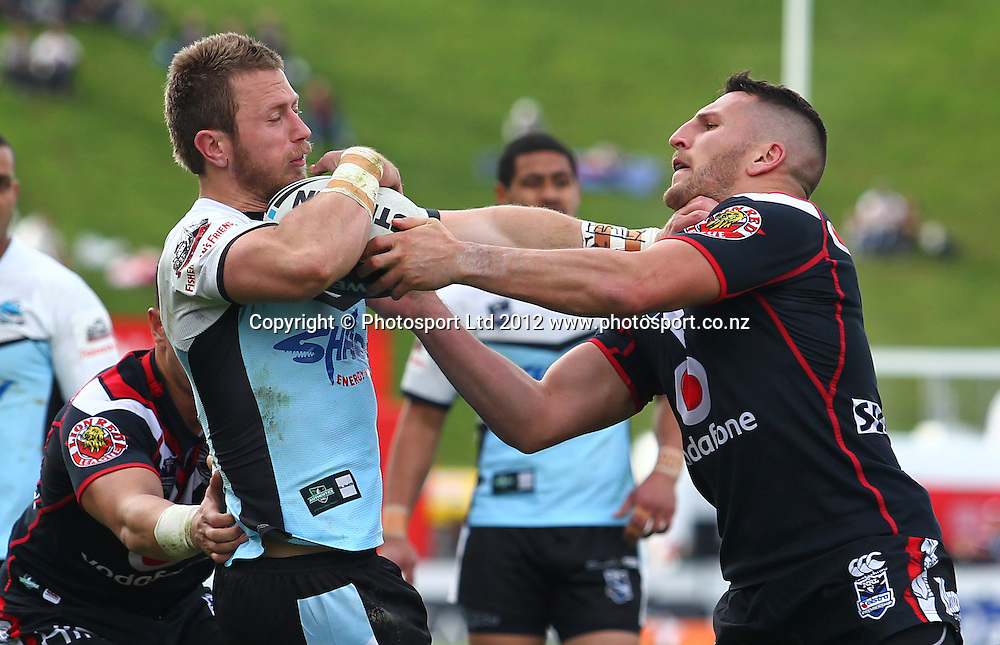 Lewis Brown of the Warriors tackles Nathan Stapleton of the Sharks during the NRL game, Vodafone Warriors v Cronulla Sharks, Mt Smart Stadium, Auckland, Sunday 5 August  2012. Photo: Simon Watts /photosport.co.nz
