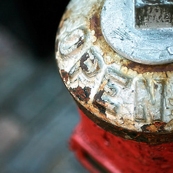 Close-up of a red and white fire hydrant.