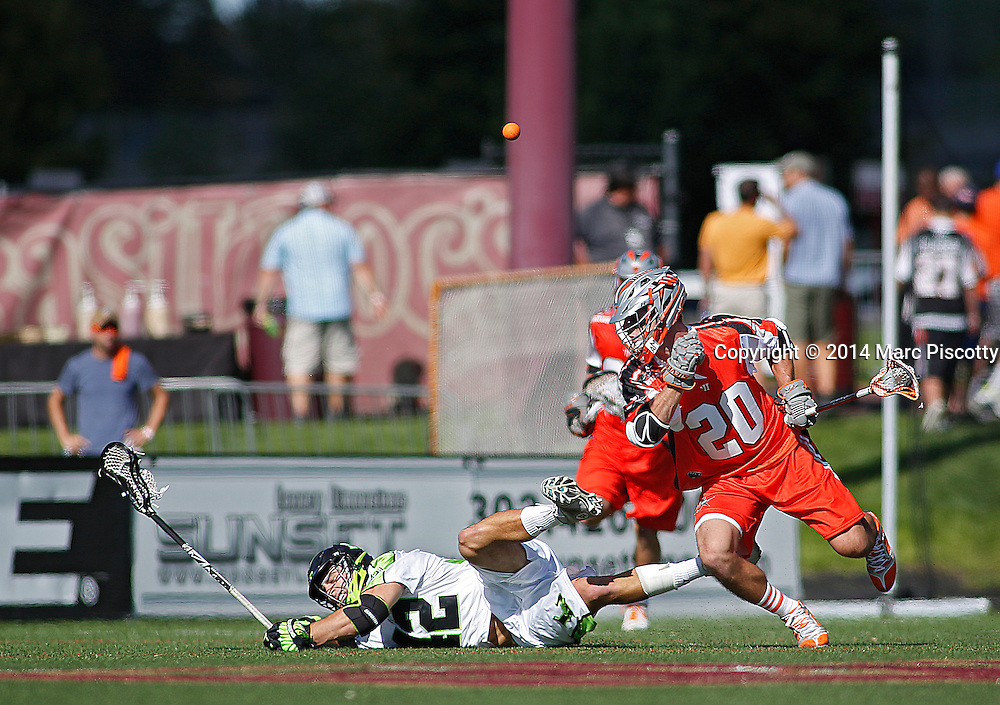 SHOT 8/16/14 4:28:46 PM - The Denver Outlaws Jeremy Sieverts #20 lays a hit on the New York Lizards Max Seibald #42 during their MLL Semifinals matchup at Peter Barton Lacrosse Stadium on the University of Denver campus in Denver, Co. Saturday. The Denver Outlaws won the game 14-13 to advance. (Photo by Marc Piscotty / © 2014)
